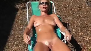 lady sunbathing with her nude pussy craving for cock